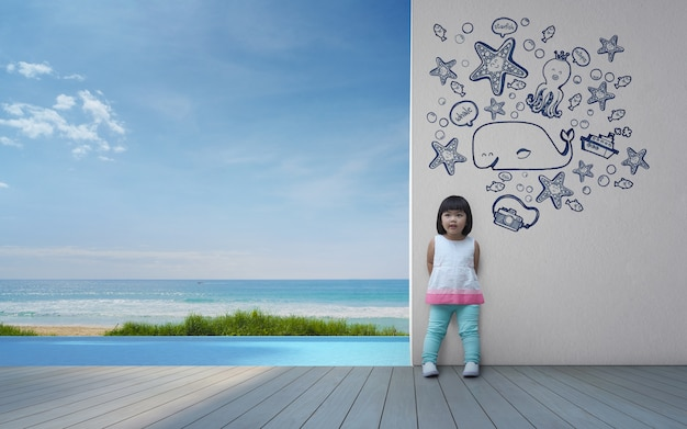 Funny asian child playing in beach house.