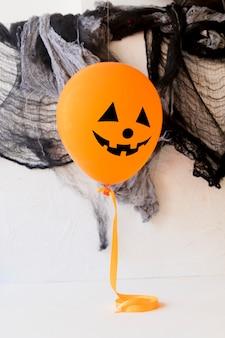 Funny balloon near halloween decorations