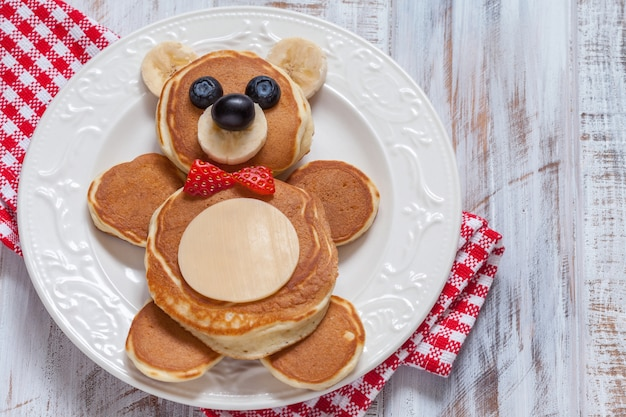 Funny bear pancakes with berries for kids breakfast