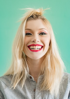 Funny beautiful sexy woman with funny hairstyle and glamorous makeup and hairstyle on white backgrou...
