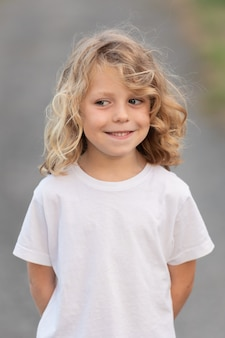 Funny blond kid with long hair