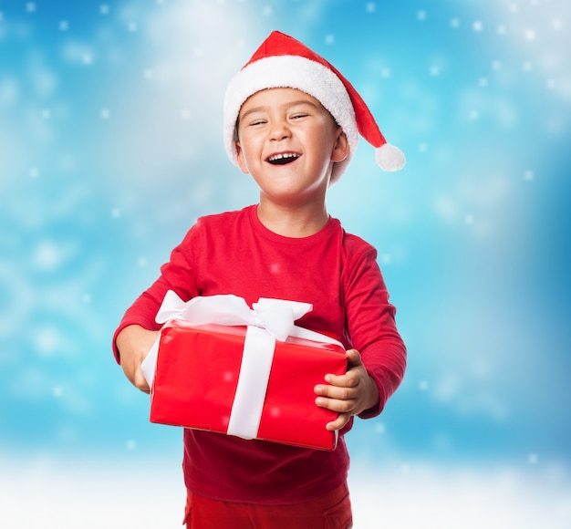 Funny boy grabbing his christmas with both hands