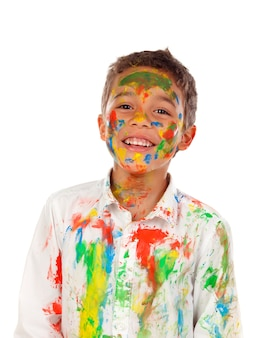 Funny boy with hands and face full of paint