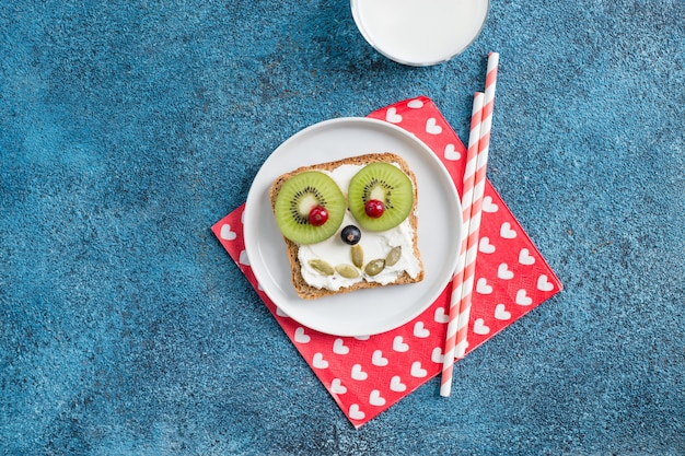 Funny breakfast animal faces toasts with spreads
