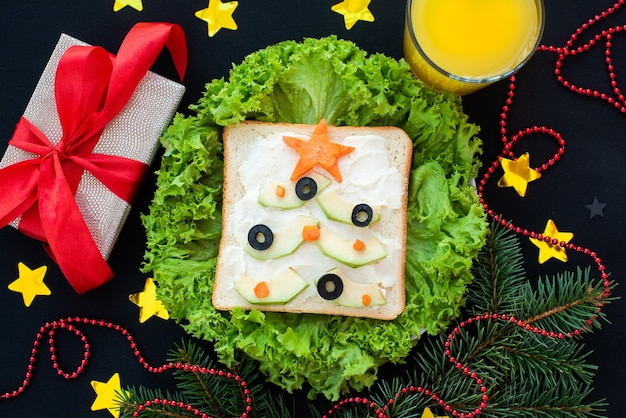 Funny breakfast, sandwiches in the form of christmas trees.