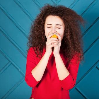Funny brunette girl portrait on blue background