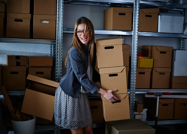 Funny businesswoman holding storage boxes