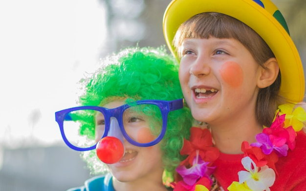 Funny carnival kids smiling and playing outdoor
