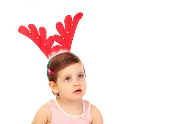 クリスマスのトナカイの角を着て面白い子