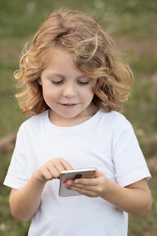 Funny child with long hair holding a mobile