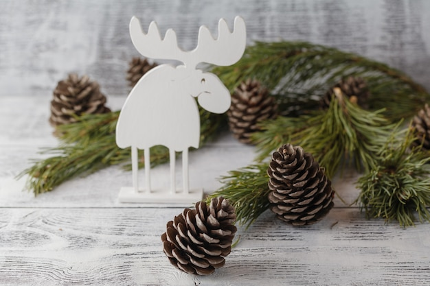 Funny christmas card with reindeer  for a greetings on a wooden table