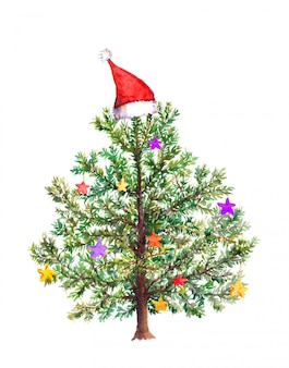 Funny christmas tree with decorative baubles in red santa's hat. watercolor