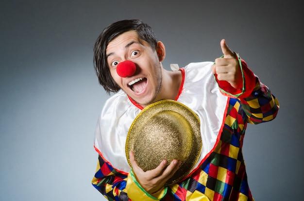 Funny clown on dark