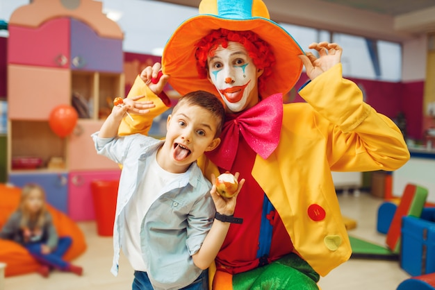 Funny clown, entertainment show with little boys