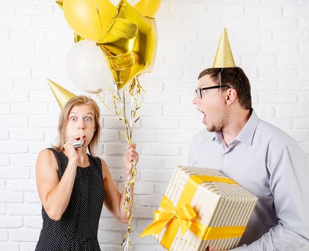 Funny couple celebrating birthday party