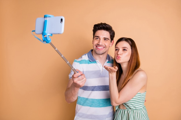 Funny couple enjoy travel blogging on summer vacation