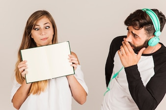 Funny couple showing open book