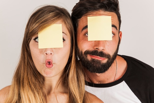 Funny couple with post its on head