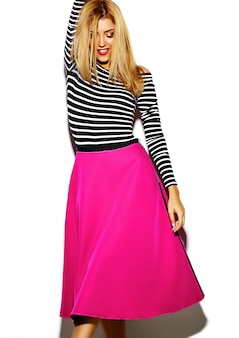 Funny crazy glamor stylish sexy smiling beautiful blond young woman model in pink hipster clothes in studio