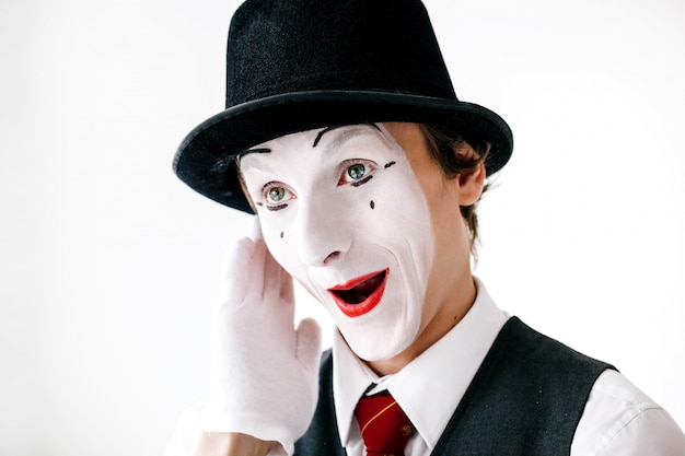 Funny curious mime hears something