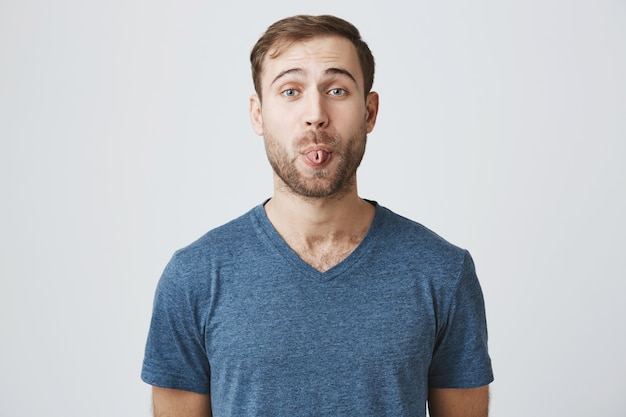 Funny cute bearded man curl tongue silly