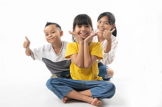 Funny and cute group of asian children looking and surprise