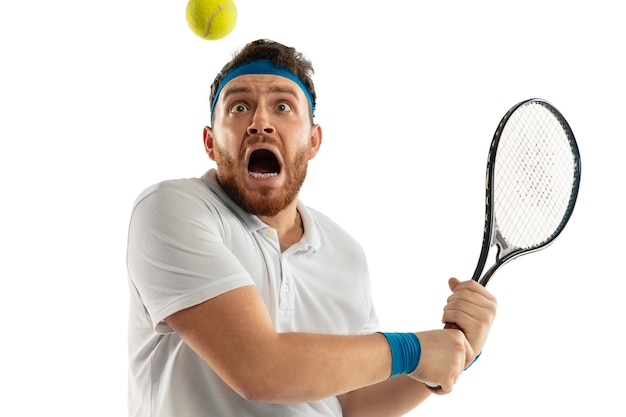 Funny emotions of professional tennis player isolated on white  wall, excitement in game