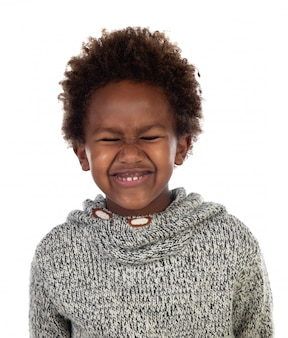 Funny expression of a small african child with clossed eyes