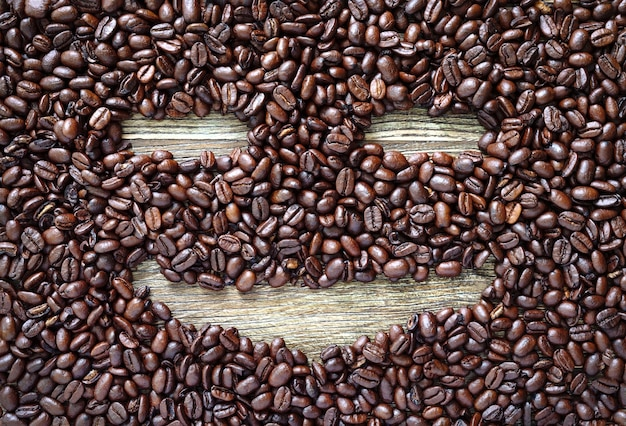 Funny face made from coffee beans. creative vision of the coffee theme. the pleasure of coffee.