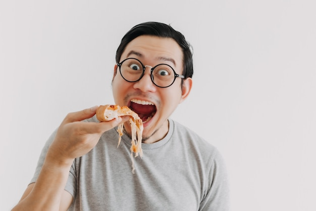 Funny face nerd man has cheesy pizza isolated on white background