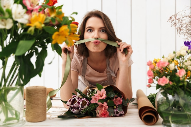 Funny florist woman working with flowers