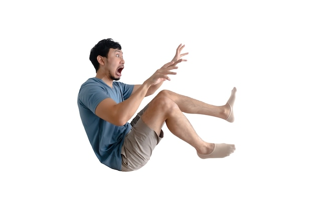 Funny full body of shocked asian man being blown away isolated.