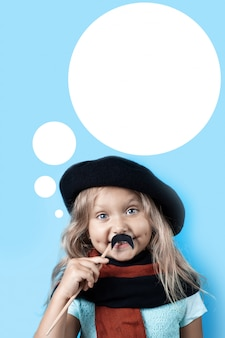 Funny girl in black beret, scarf and mustache on a stick on blue background