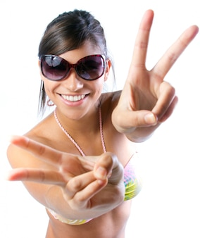 Funny girl gesturing peace with two hands