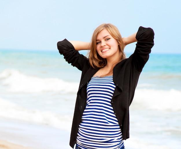 Funny girl at outdoor near sea