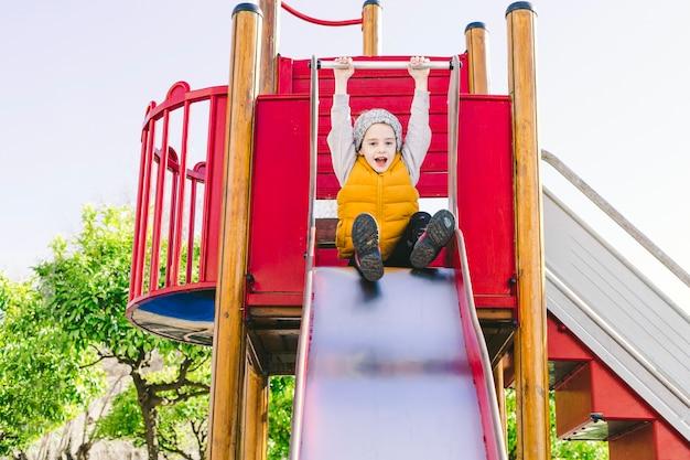 Funny girl on slide
