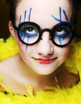 Funny girl with brigjt make up