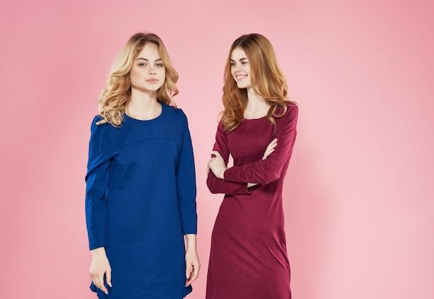 Funny girlfriends friendship lifestyle fashion studio pink background