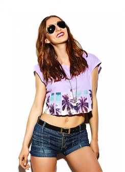 Funny glamour stylish sexy smiling beautiful young woman model in summer bright  hipster cloth