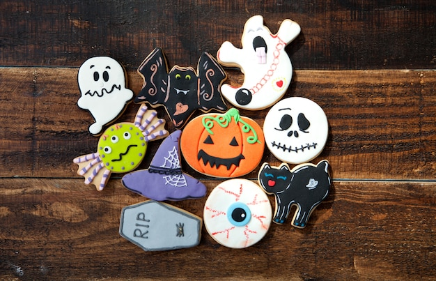 Funny halloween cookies on a wooden background