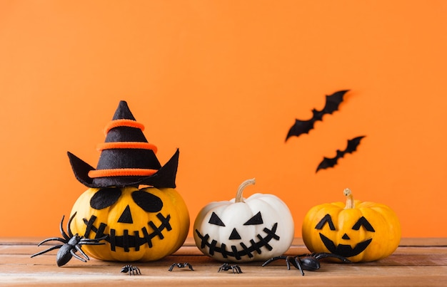 Funny halloween day decoration party, pumpkin ghost scary jack o lantern face, black spider and bats