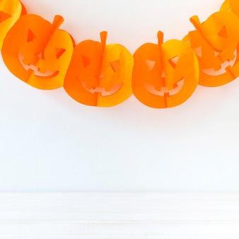 Funny halloween garland hanging on wall