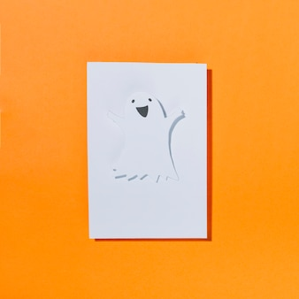 Funny halloween ghost on piece of paper