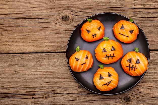 Funny halloween sushi pumpkins jack o lantern, sushi monsters. temari sushi, sushi balls. healthy food for kids