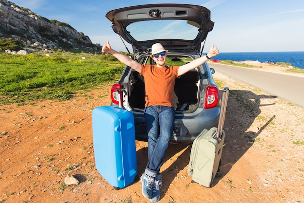 Funny happy man going on summer vacation. car travel concept.