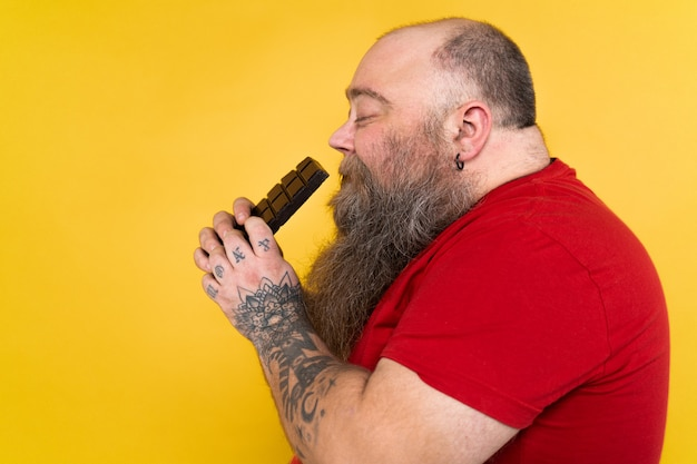 Funny and hilarious fat man hungry for unhealthy food