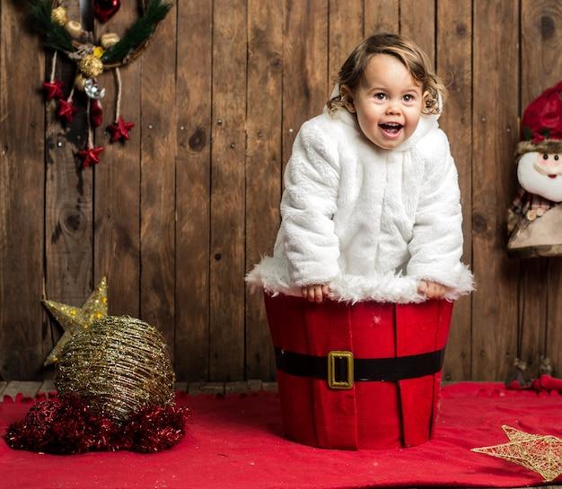 Funny kid playing on christmas stage