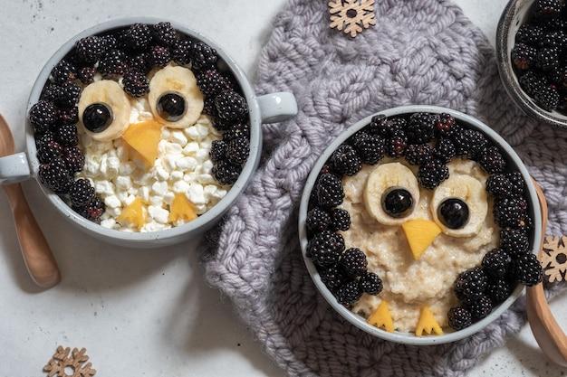 Funny kids breakfast porridge penguin with fresh berries