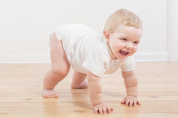 Funny little  baby on wood floor