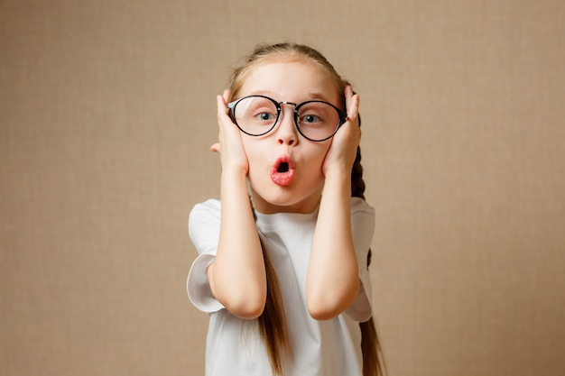 Funny little girl in a glasses